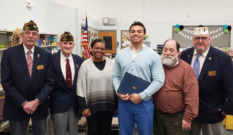 Andrew with his parents and VFW representatives