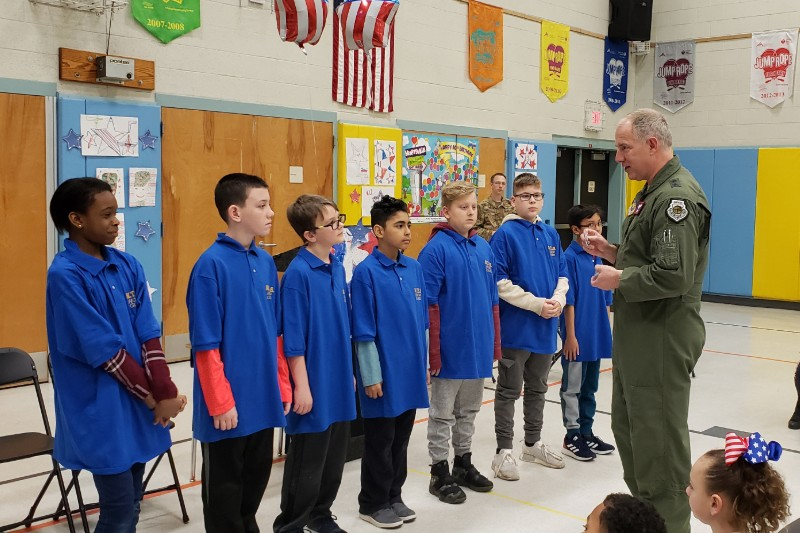 General Gordy presents coins to color guard